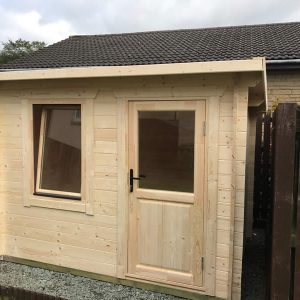 Log Cabin Aral with glass panel door